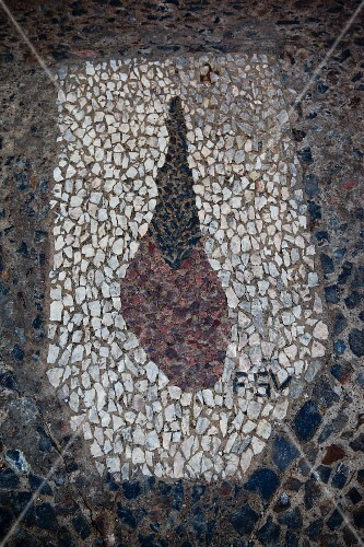 Detail of a stone mosaic of a leg of jamon de jabugo for which Andalucia is famous
