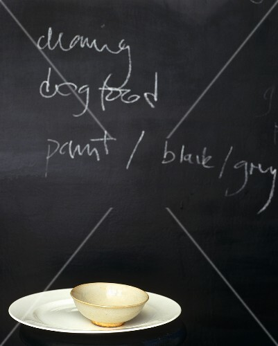 A blackboard in the kitchen serves as an aide-memoire to buy dog food and other vital things