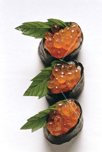 Sushi: three gunkan-maki with caviare