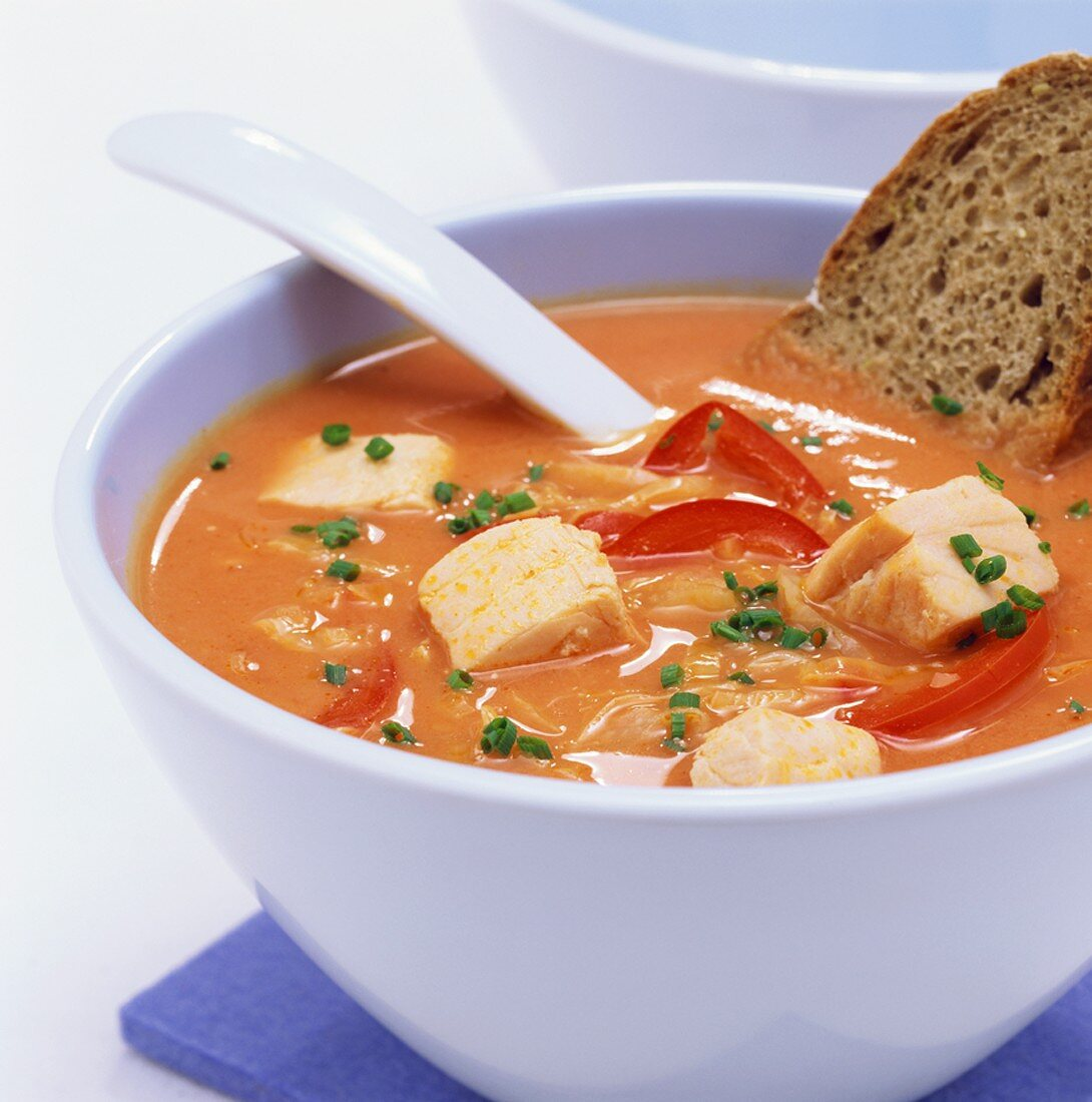 Pepper and cabbage soup with diced salmon