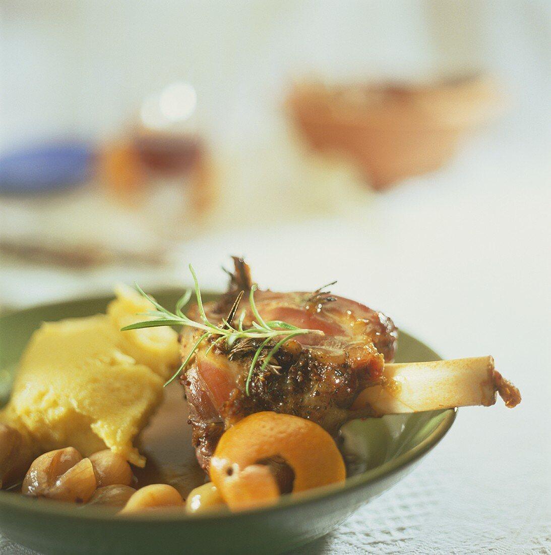 Rosemary-studded lamb shank with polenta