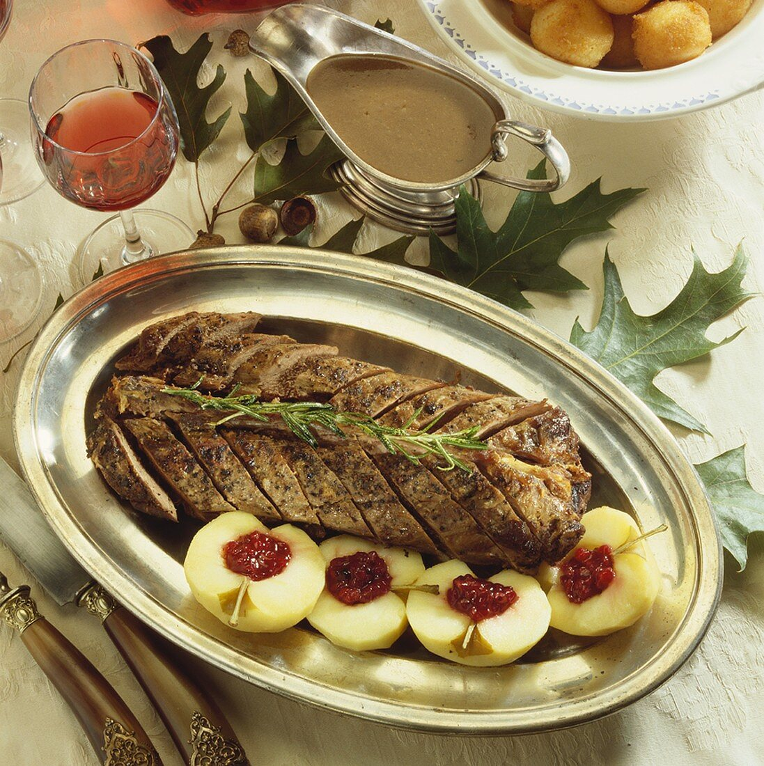Saddle of venison with apples and cranberries