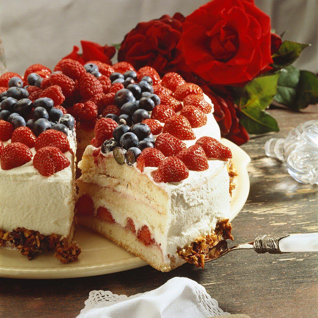 Mixed berry sponge cake, a piece cut