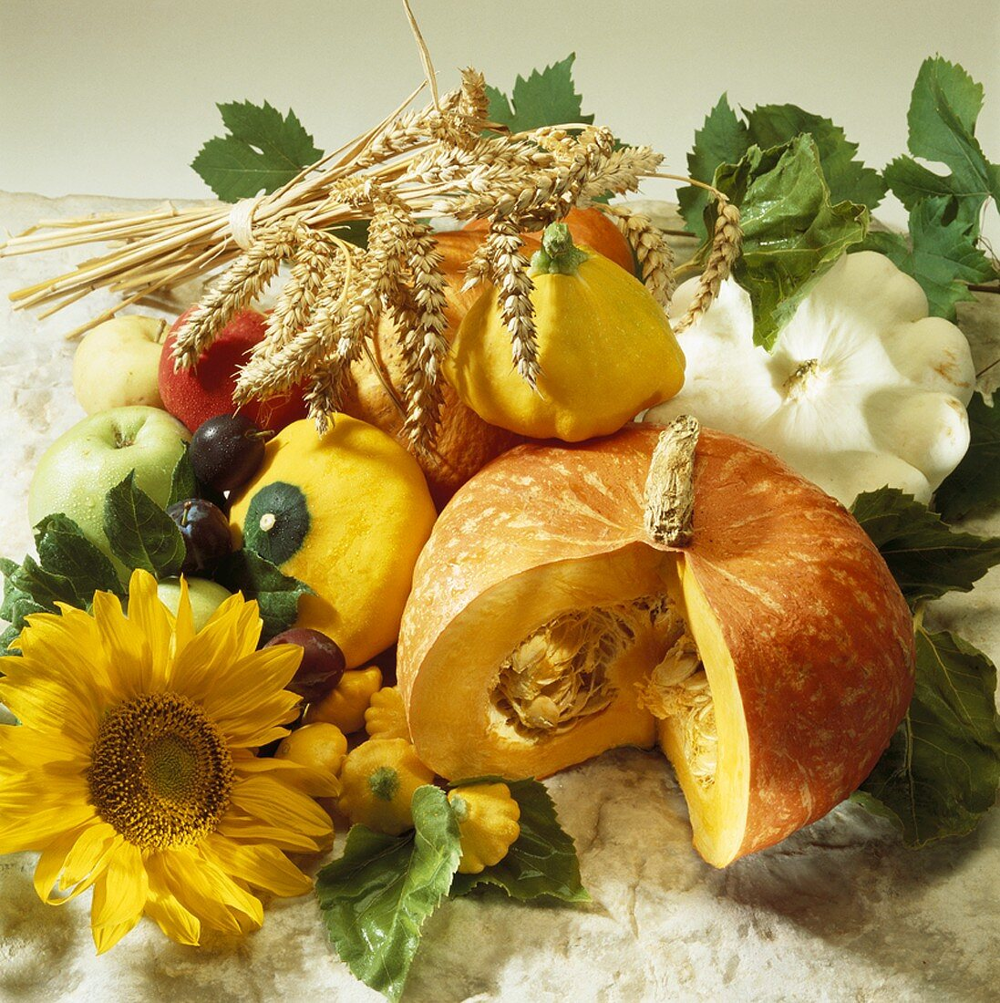 Autumn still life with squashes, pumpkins, fruit & cereals