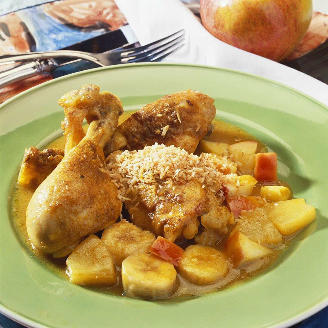 Curried chicken with grated coconut and fruit