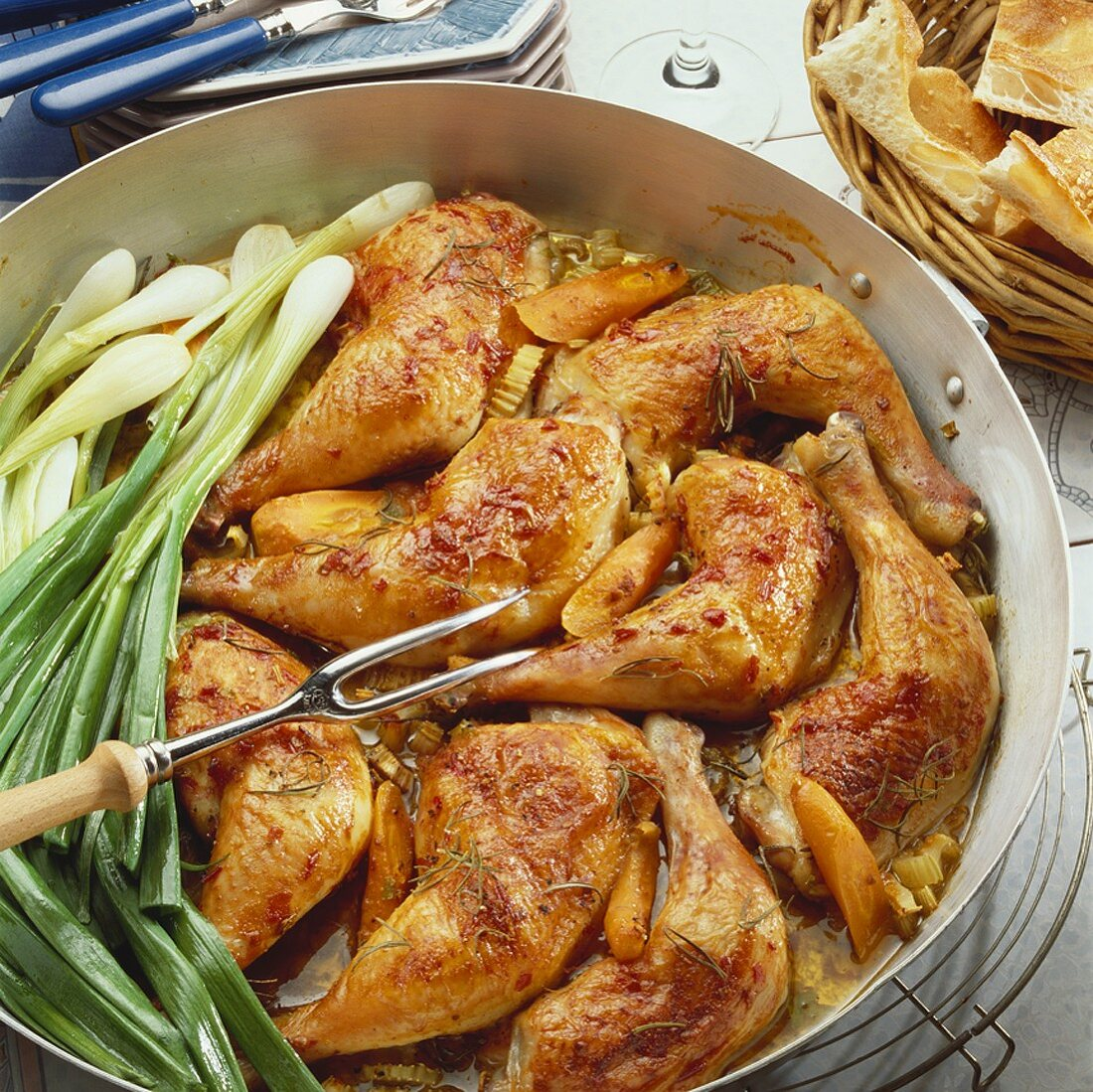 Braised chicken legs with vegetables and rosemary