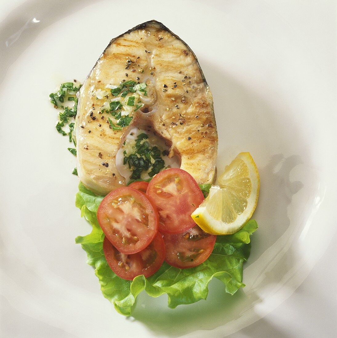 Grilled fish cutlet (sturgeon) with salad