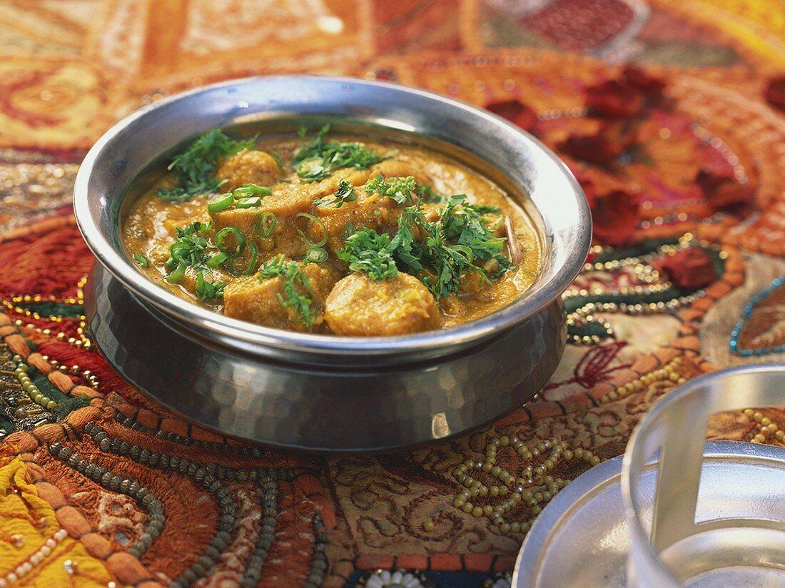 Gatte ka saag (chick-pea flour dumplings in curry sauce, India)