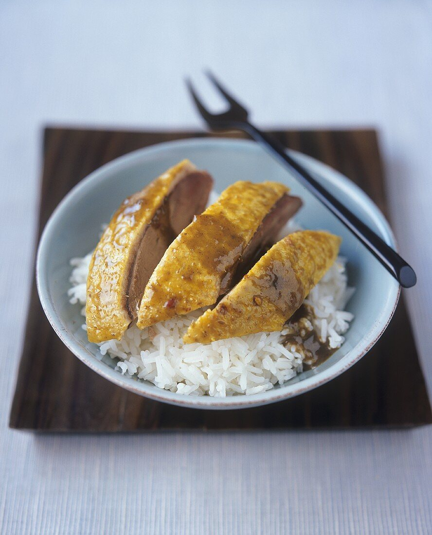 Balinese-style roast duck with rice