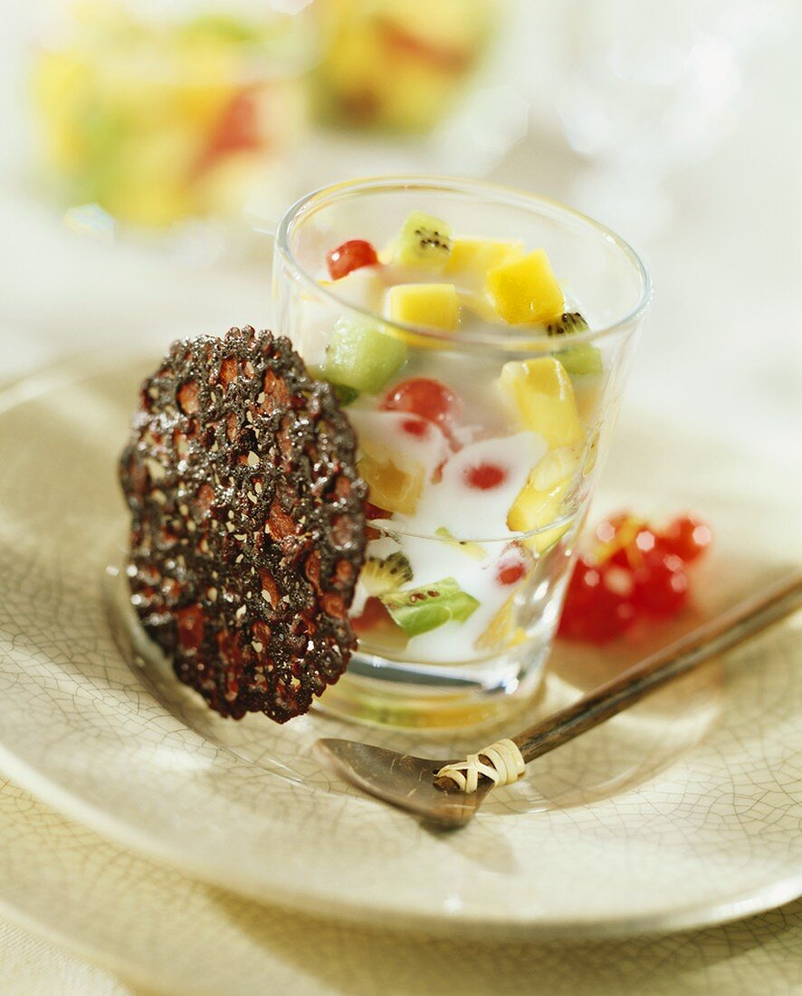Fruit salad with coconut milk and a biscuit