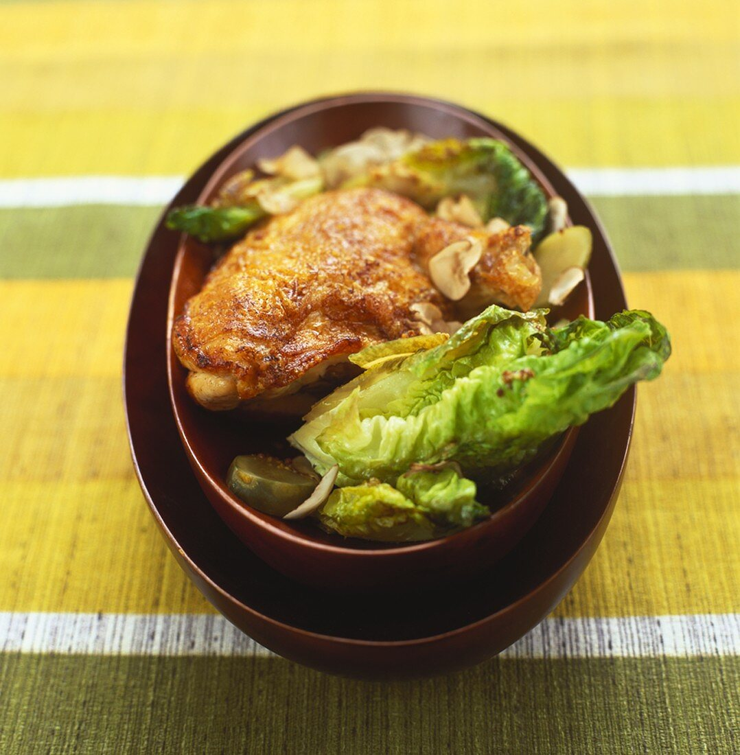 Whole chicken breast with lettuce and mushrooms