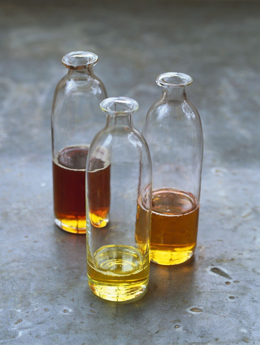 Three different oils in glass bottles
