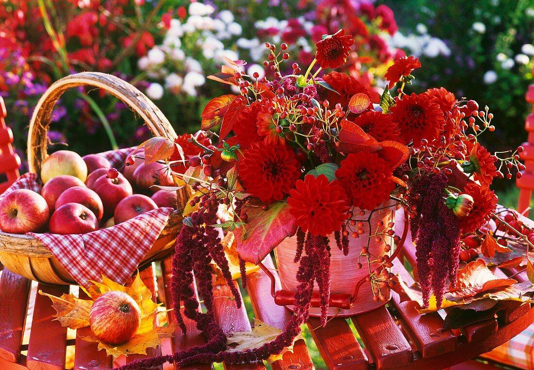 Arrangement of dahlias, rose hips, foxtail & autumn leaves