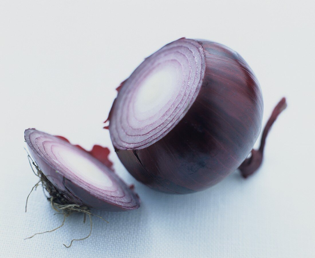 A red onion with a slice cut off