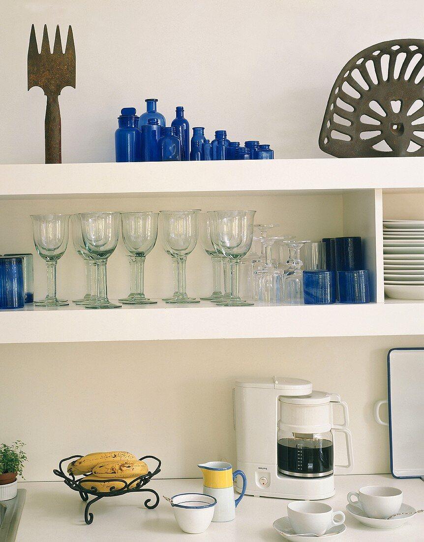 Shelves of crockery in a kitchen