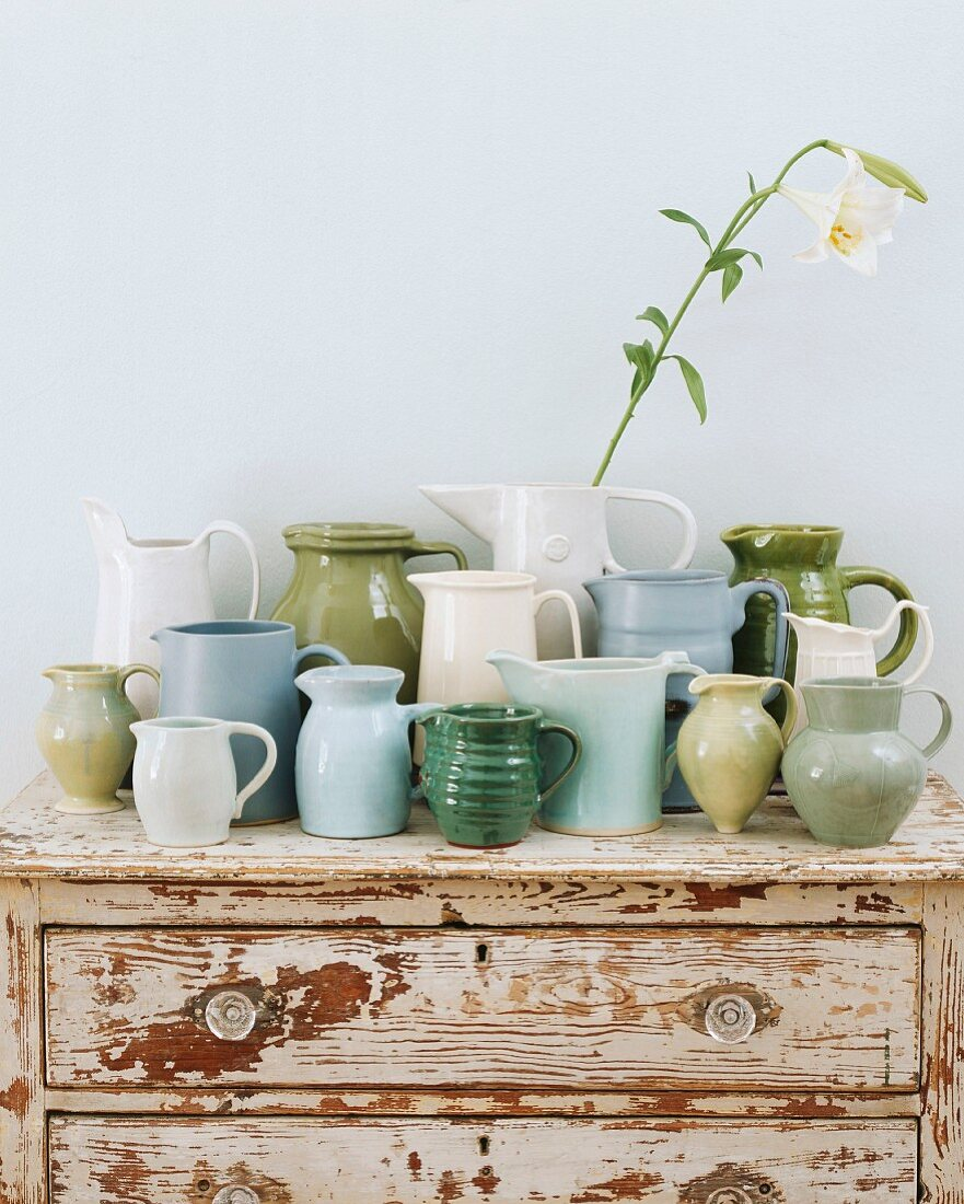 Jugs on wooden chest of drawers