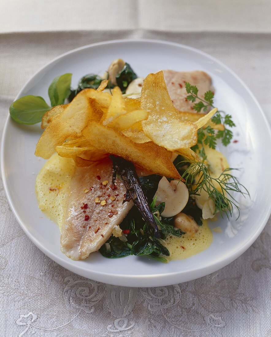 Poached trout on spinach with potato crisps