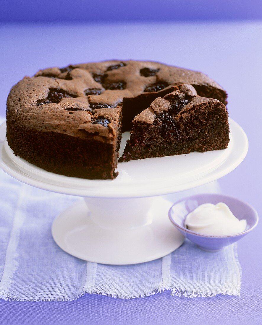 Chocolate blackberry cake on cake stand