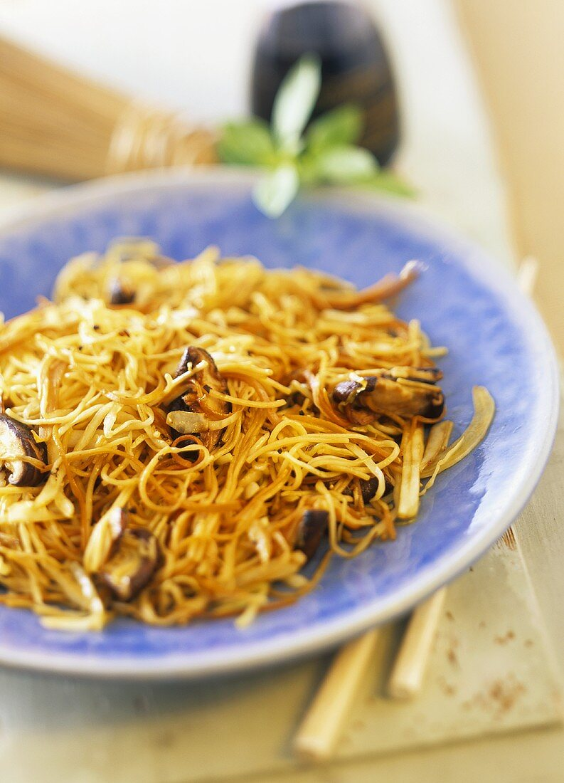 Stir-fried egg noodles with cabbage and shiitake mushrooms