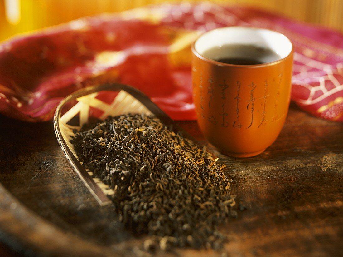 Pu-erh tea: tea leaves and bowl of tea