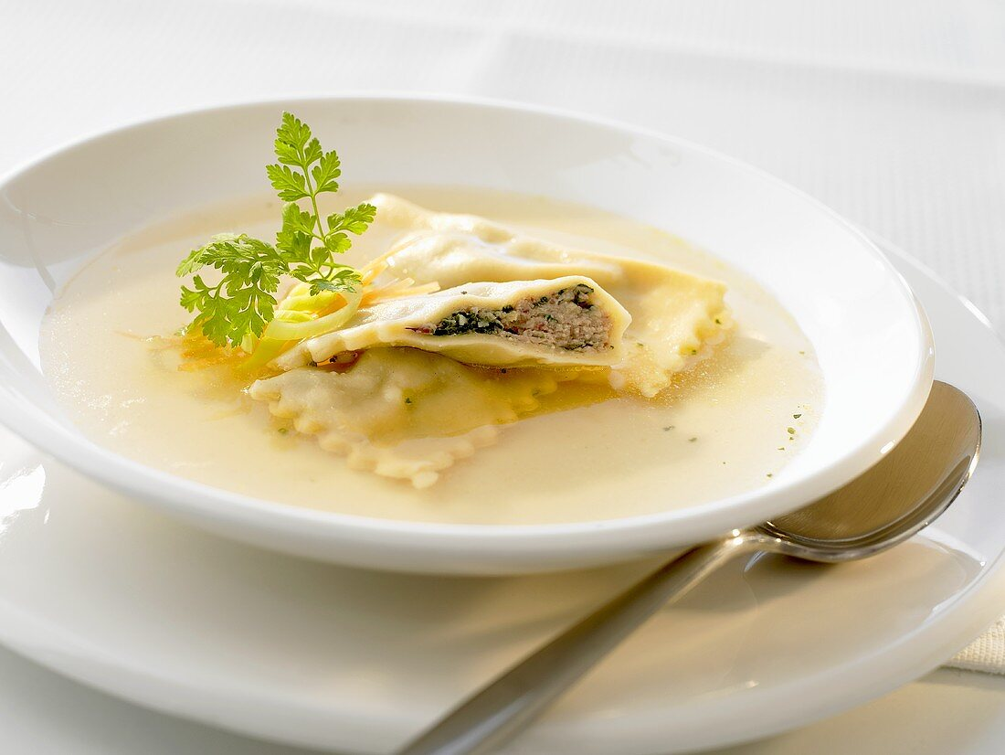 Soup with filled pasta envelopes