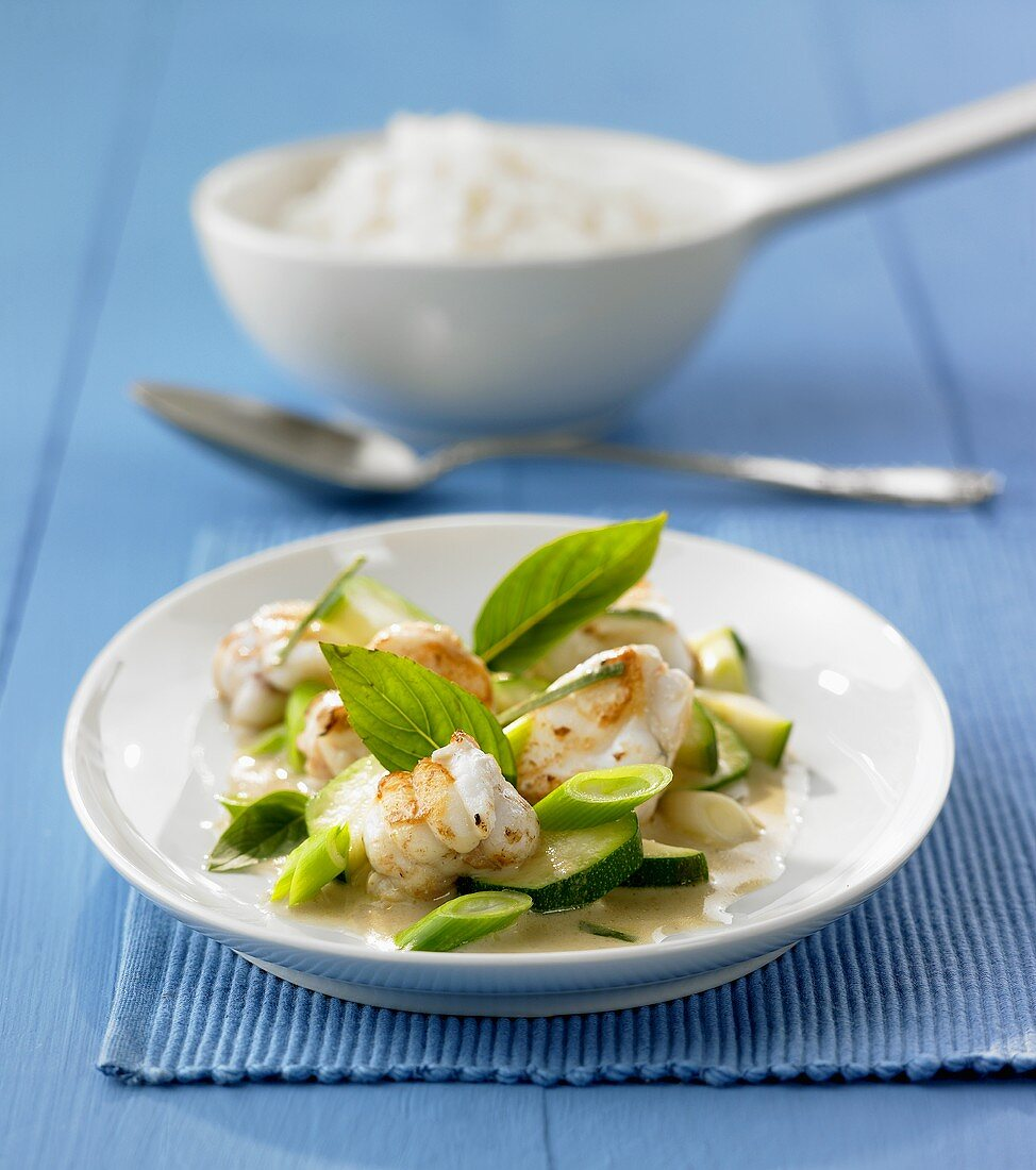 Monkfish with courgettes in green coconut curry sauce
