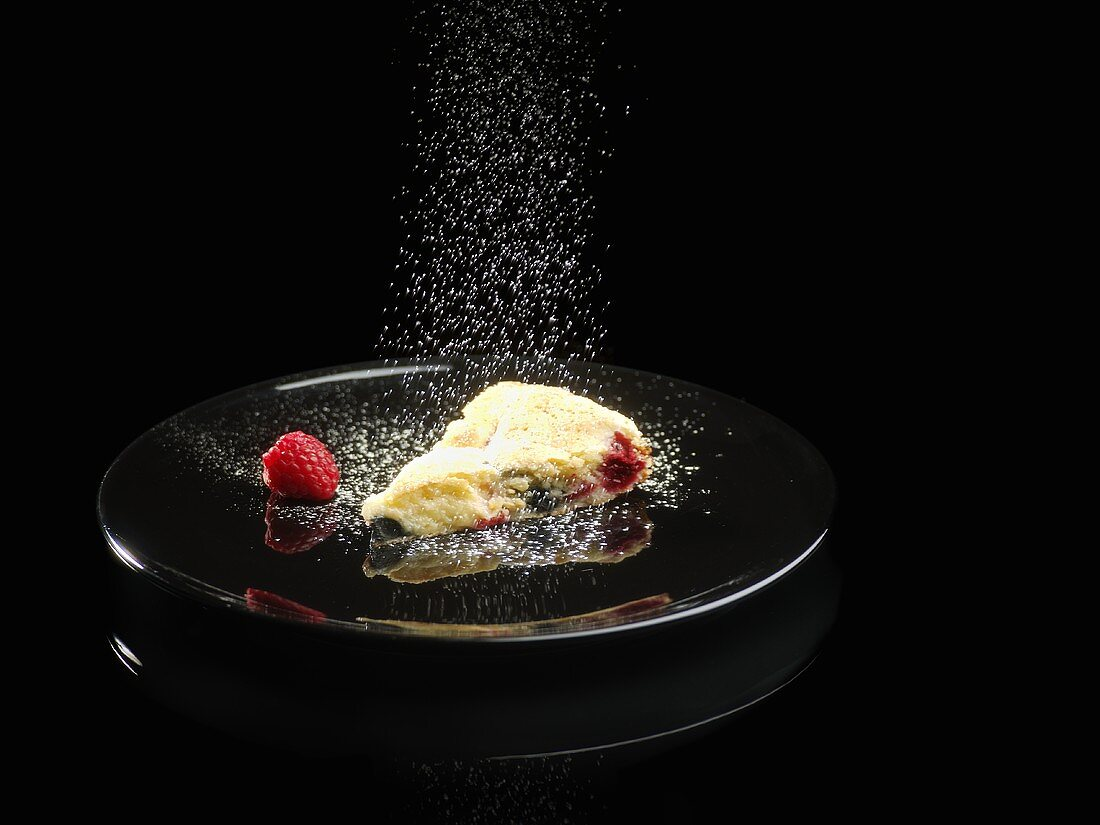A piece of raspberry and liquorice cake