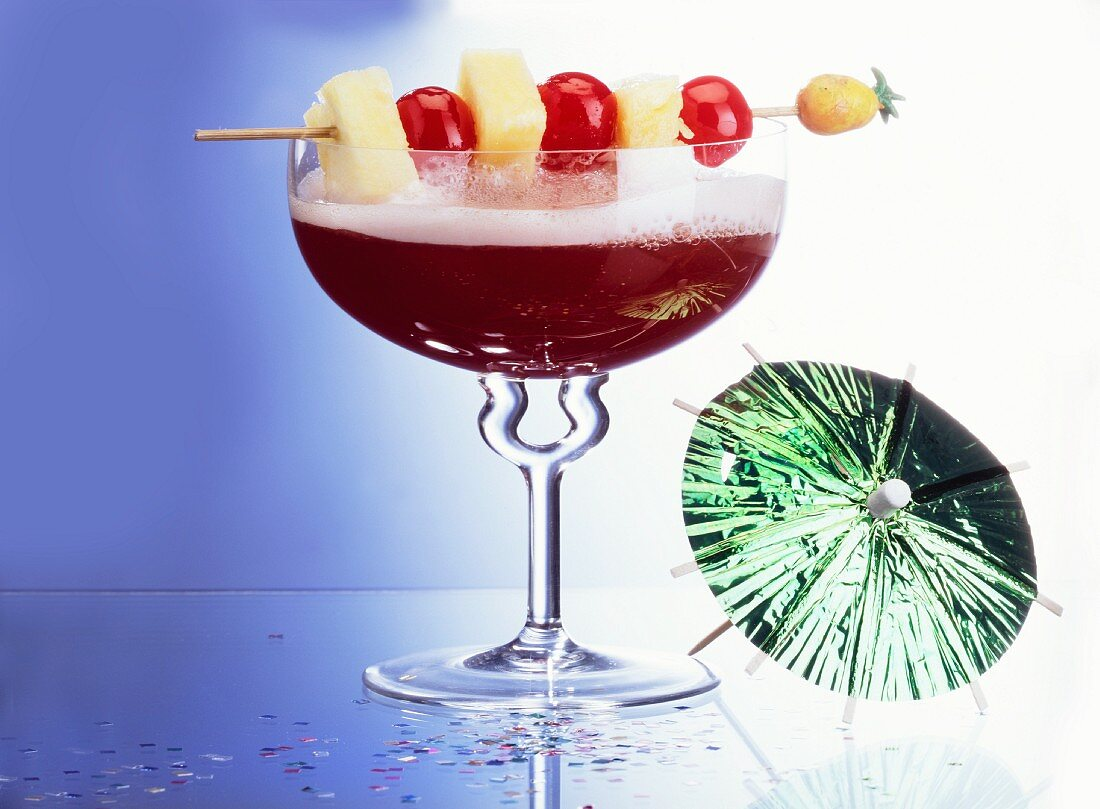 Red Kiss Champagne Cocktail with Fruit; Umbrella