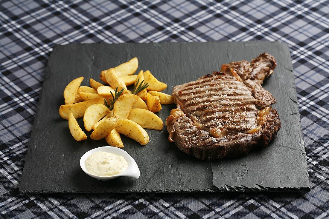 Beef steak with baked potato wedges