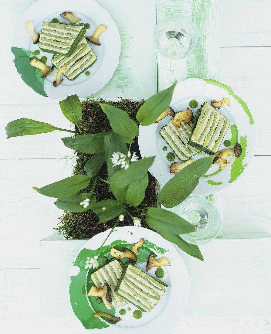 Potato & ramsons (wild garlic) terrine with ramsons oil & mushrooms