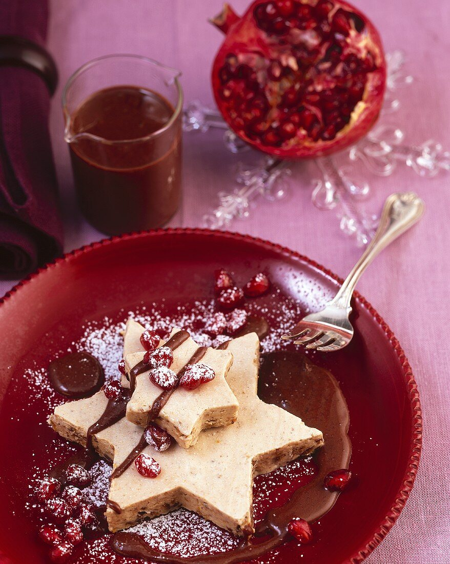 Gingerbread parfait with chocolate sauce & pomegranate seeds