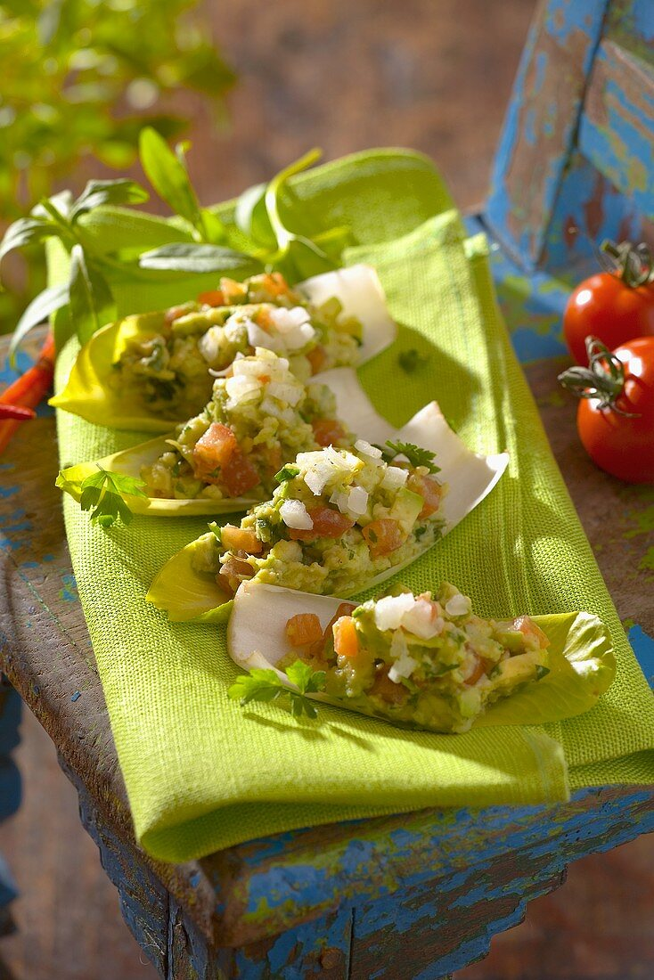 Guacamole on chicory leaves (finger food)