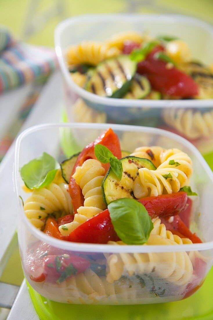 Pasta salad with grilled vegetables in food storage boxes