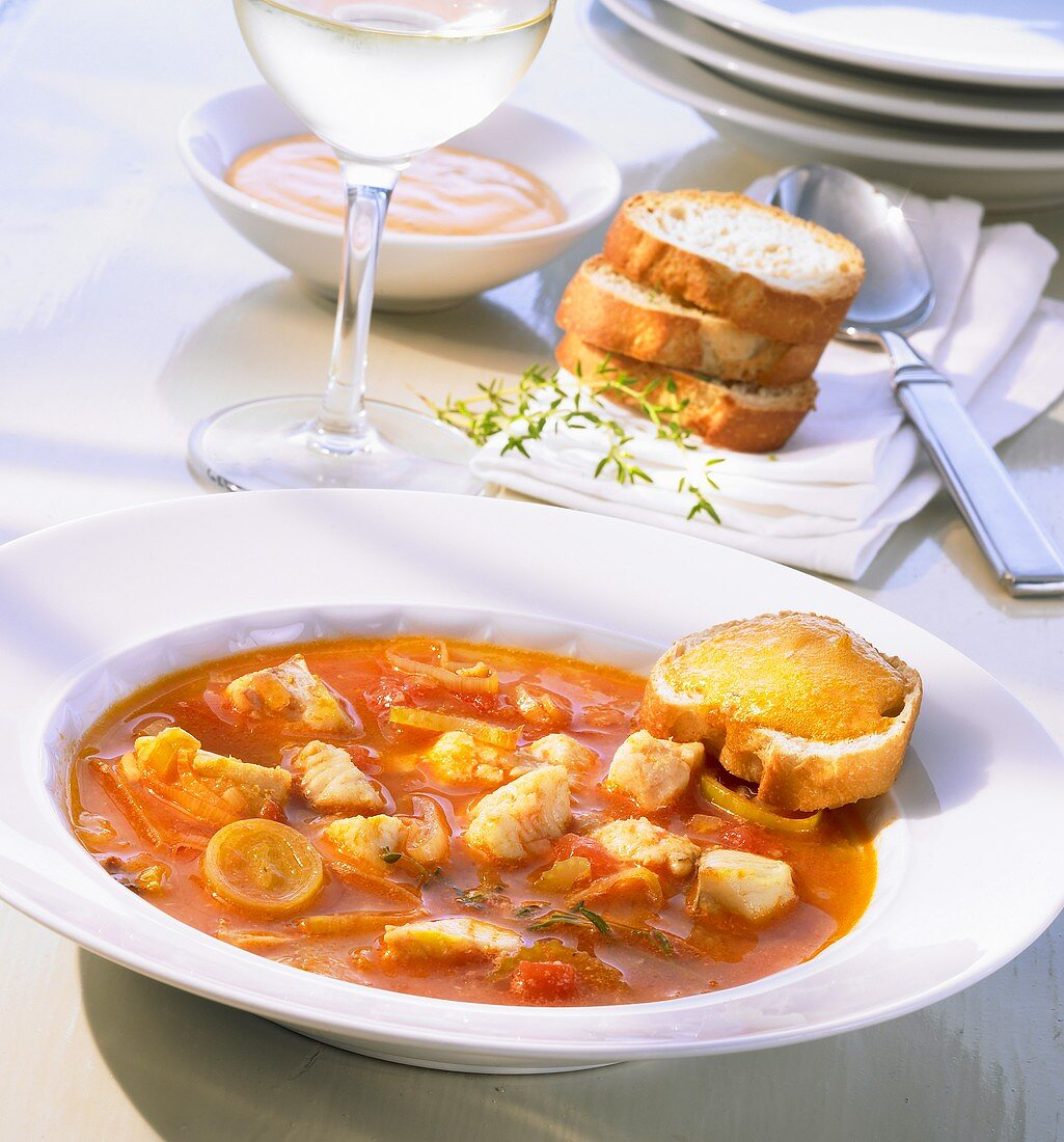 Bouillabaisse with toasted white bread and rouille