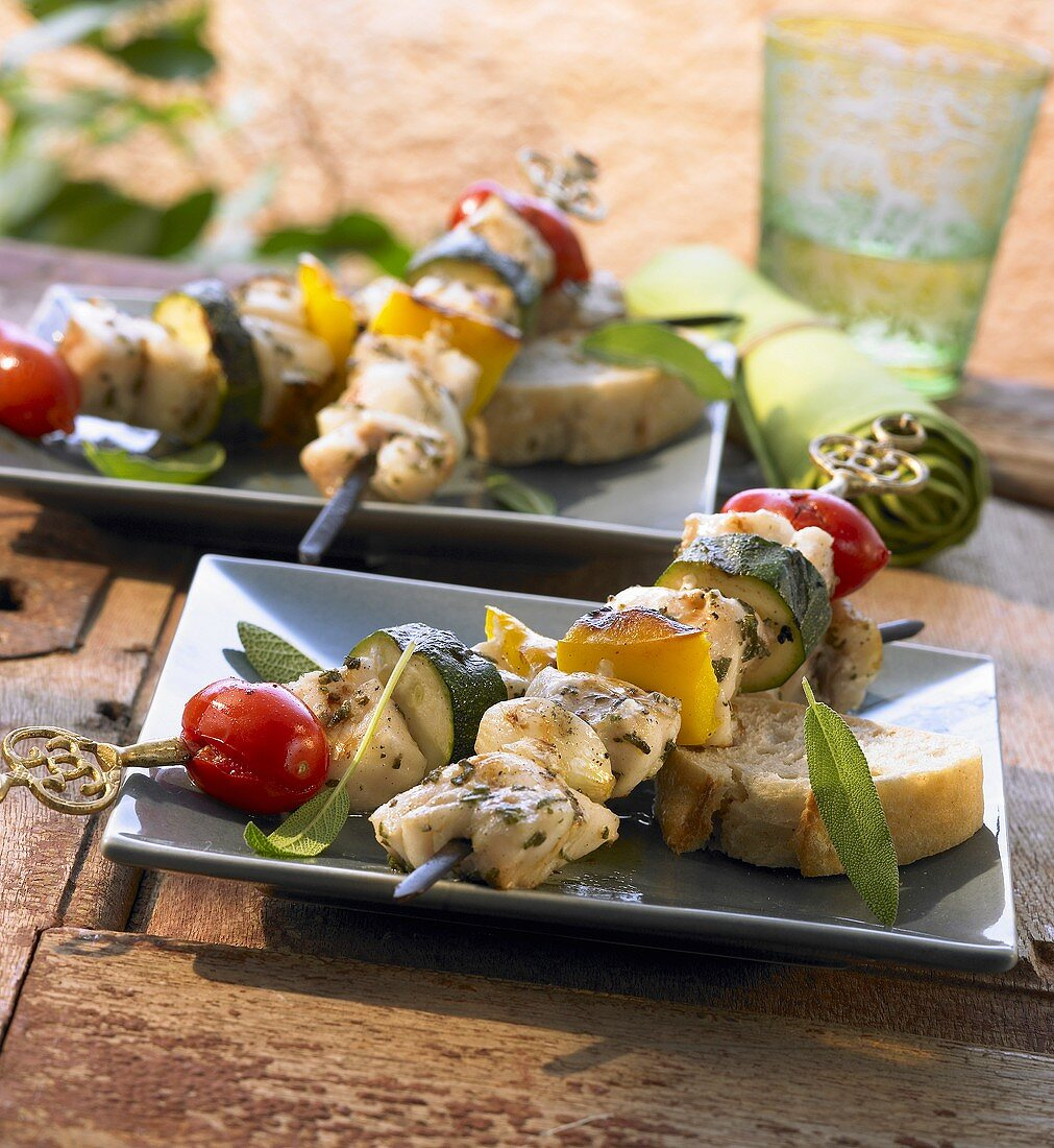 Grilled fish, tomato, pepper and courgette kebabs