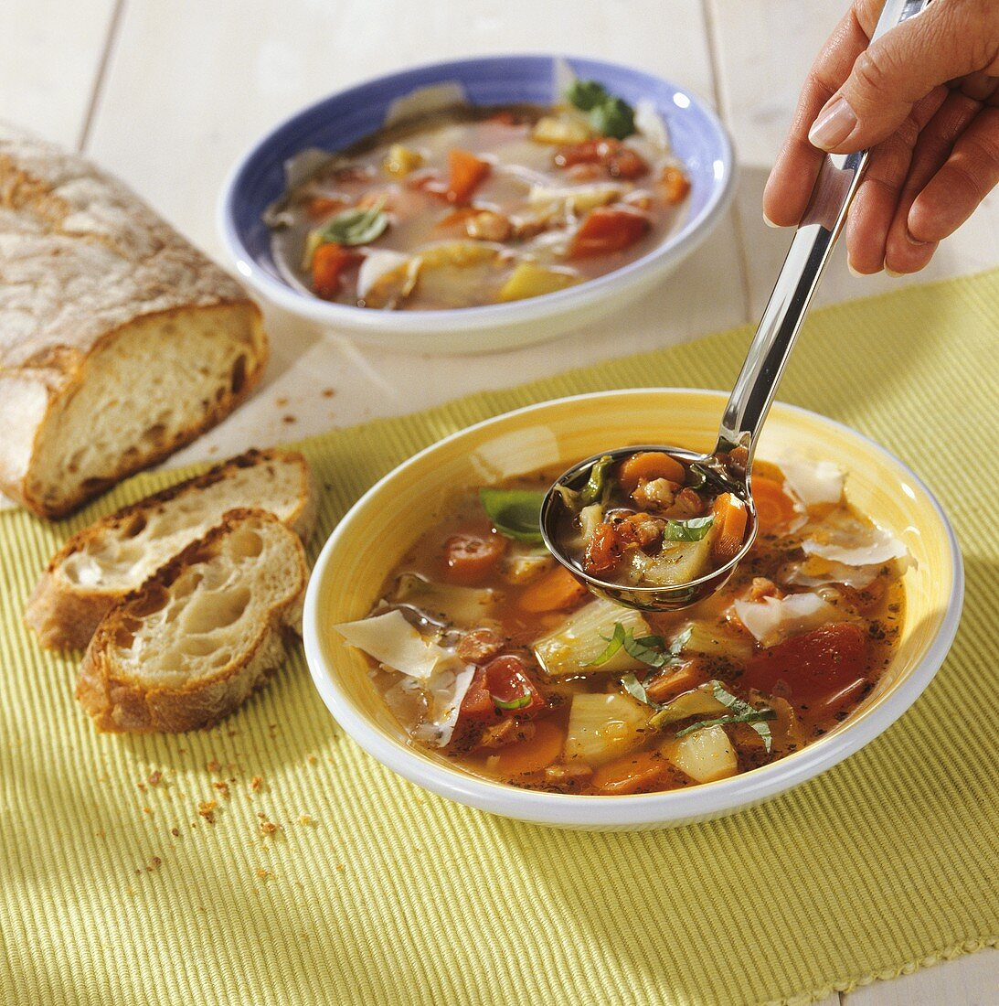 Minestrone primavera (Vegetable soup with bread, Italy)