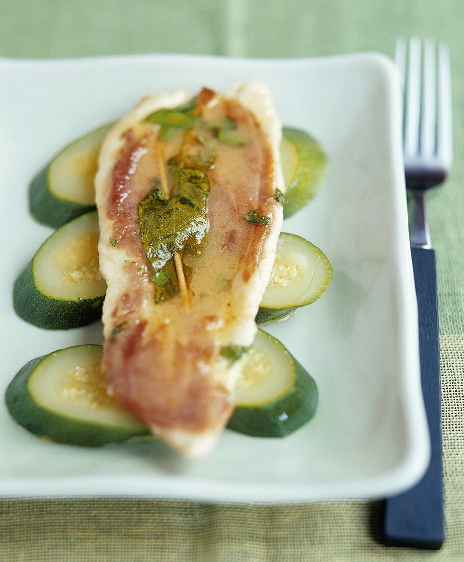 Chicken saltimbocca on courgette slices