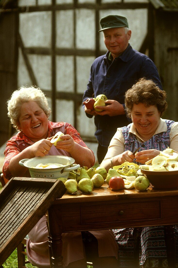 Women peeling fruit
