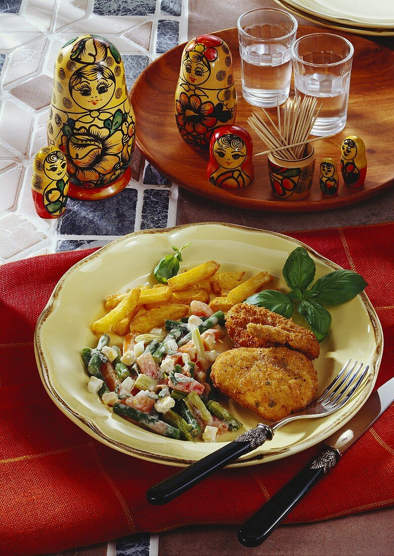 Breaded chicken cutlet with mixed vegetables & chips (Kiev, Ukraine)