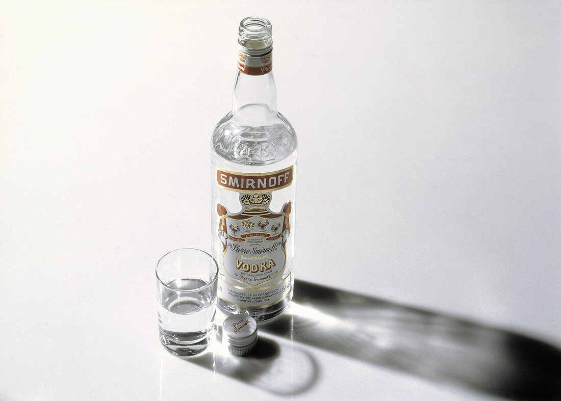 A Bottle of Vodka with a Shot Glass