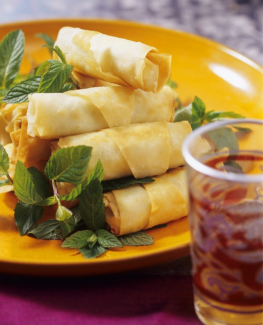 Filo pastry rolls filled with spicy sheep's cheese