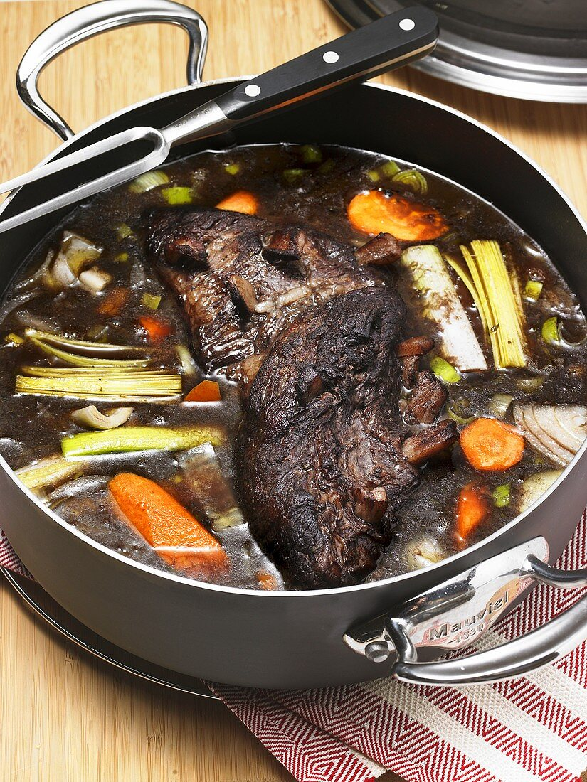 Boeuf à la mode (Marinated beef with soup vegetables)