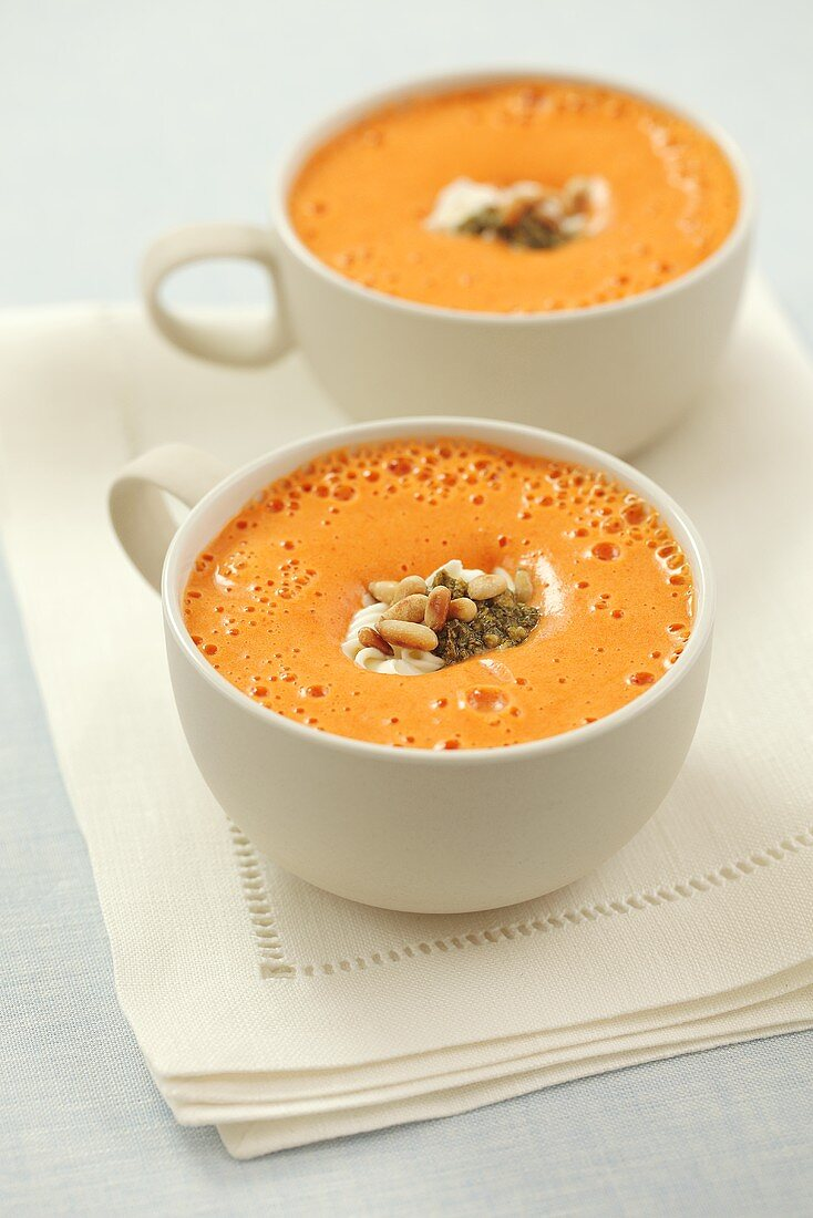 Pepper soup with sour cream and pesto