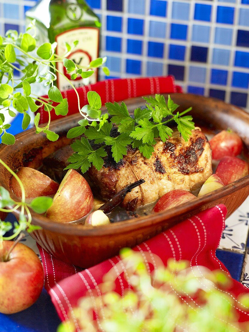 Pork roulade with apples in a clay dish