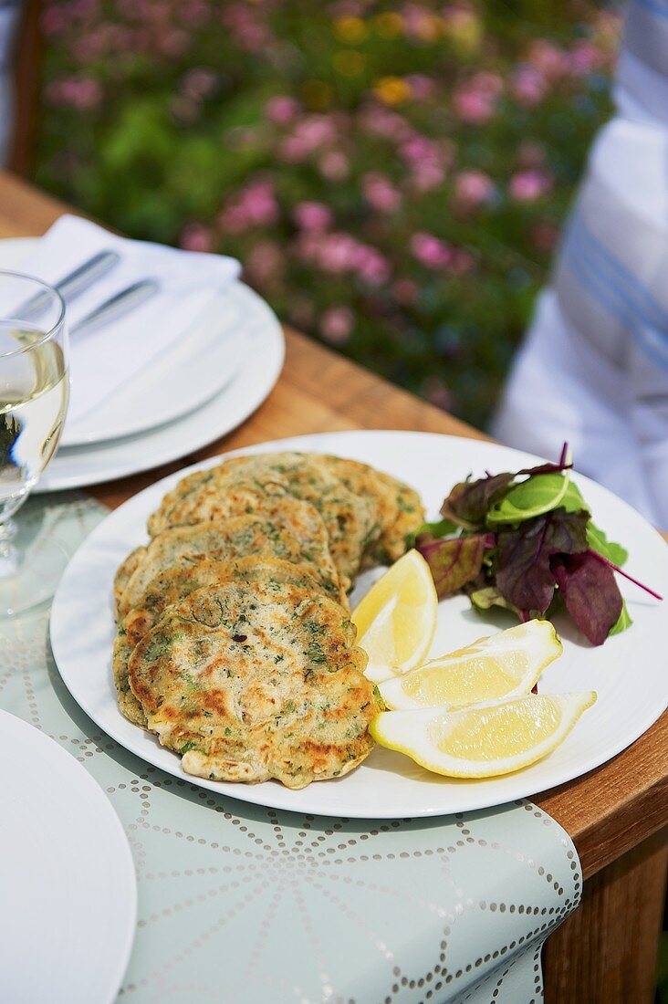 Herb pancakes with lemon slices
