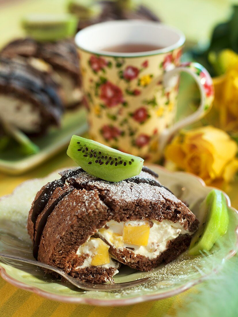 Chocolate sponge roll with a mango-cream filling