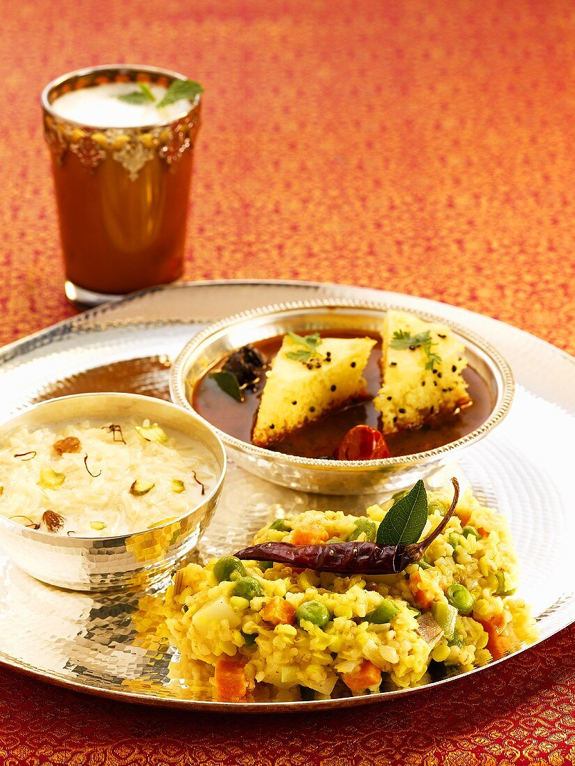 Dishes from Gujarat: khichdi (rice dish), kheer (rice dessert), dhokla (rice pastries) and chaas (buttermilk)