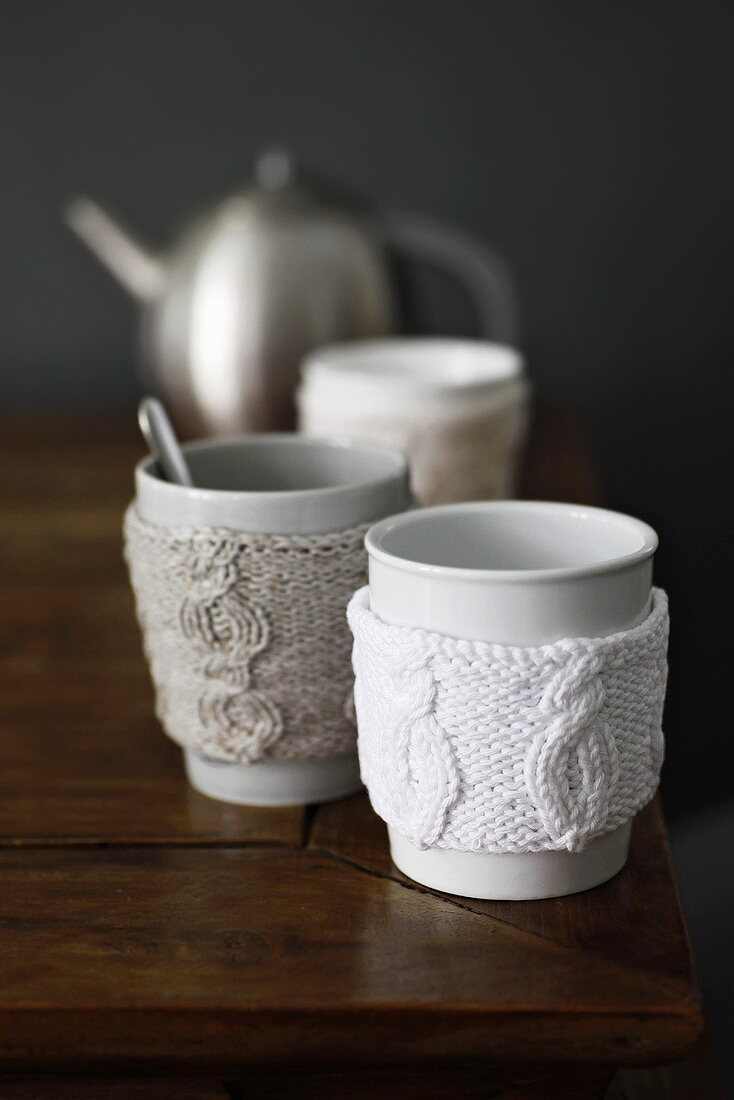 Tea cups with knitted cup warmers