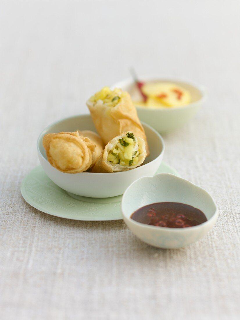 Sweet spring rolls, pineapple stuffing, chilli chocolate dip