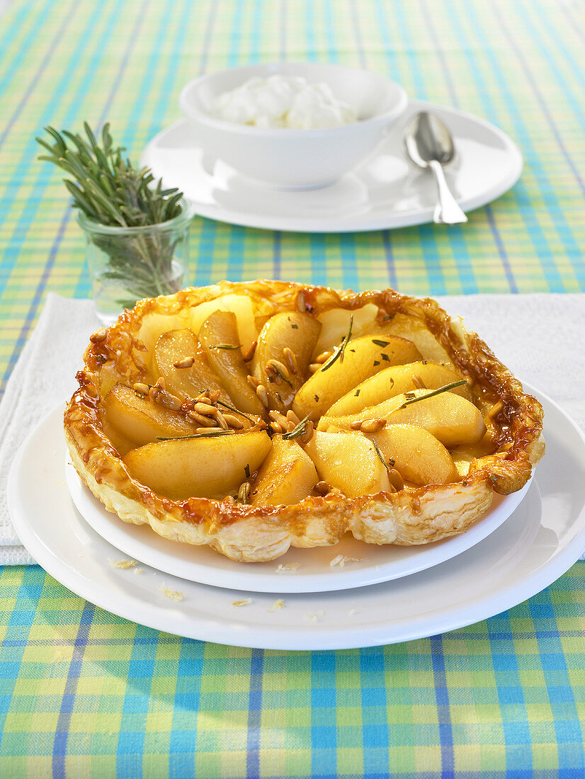 A pear and rosemary tart with whipped cream